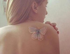 Butterfly White Ink Back Tattoo