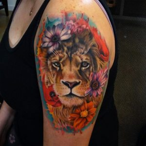 Colorful Floral Lion Arm Tattoo