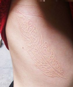 Feather White Ink Side Body Tattoo