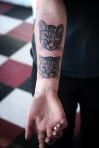 Gorgeous Cat Faces Forearm Tattoo