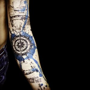 Graphic Style Compass Arm Tattoo