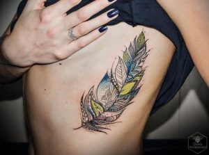 Ornamental Watercolor Feather Side Body Tattoo