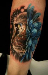 Realistic Traditional Cat Forearm Tattoo