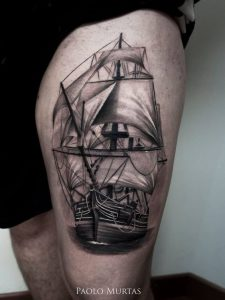 Traditional Grey Inked Ship Thigh Tattoo