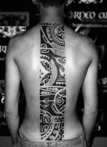 Tribal Themed Spine Tattoo