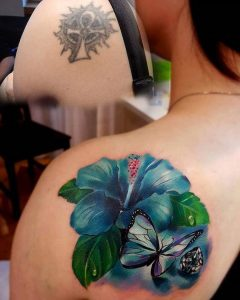 Turquoise Hibiscus With Gem And Butterfly Cover Up Back Tattoo