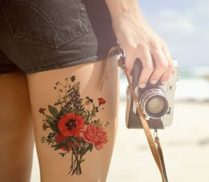 Vibrant Floral Bouquet Thigh Tattoo