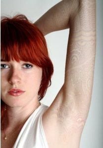 White Ink Lace Arm Tattoo