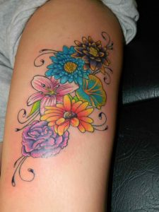 6 Colorful Flowers Thigh Tattoo