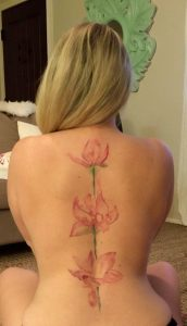 Abstract Pink Lotus Spine Tattoo