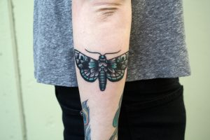 Black and Green Moth Forearm Tattoo