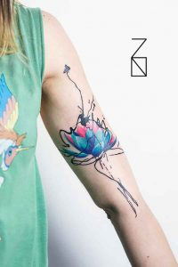 Blue Pink Lotus with Abstract Outline Bicep Tattoo