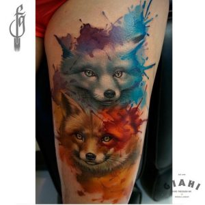 Blue and Red Foxes Thigh Tattoo