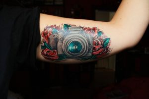 Camera with Roses Bicep Tattoo