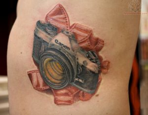 Canon Camera with Red Film Side Tattoo