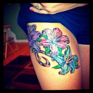 Colorful Flower Thigh Tattoo