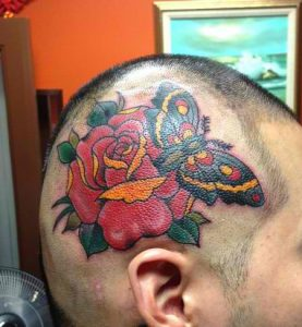 Colorful Moth and Rose Head Tattoo