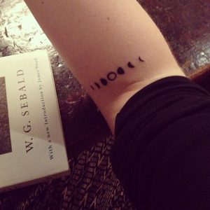 Cute Moon Phases Elbow Tattoo