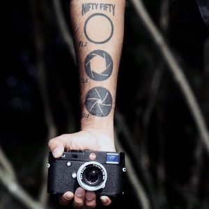 Different Apertures Forearm Tattoo