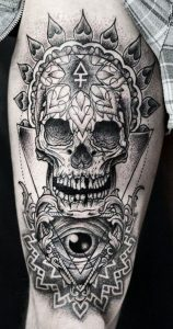 Dotted Skull and All-Seeing Eye Thigh Tattoo