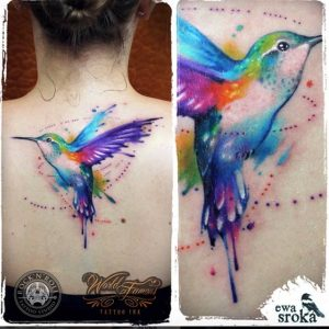 Dotworks and Watercolor Hummingbird Upper Back Tattoo