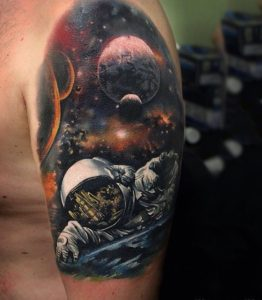 Dying Astronaut Arm Tattoo