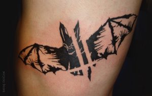 Graphical Flying Bat Thigh Tattoo