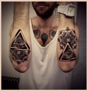 Heart Chakra and All-Seeing Eye Forearm Tattoo