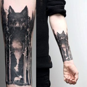 Lone Wolf in Negative Space Forest Forearm Sleeve Tattoo