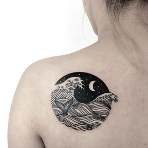Monochromatic Waves at Night with Whale Fin Shoulder Tattoo