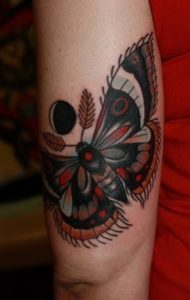 Moon and Moth Bicep Tattoo