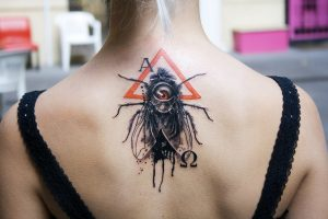 One Eyed Fly Upper Back Tattoo