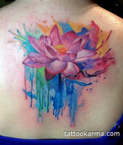 Pink Lotus with Dripping Colored Background Upper Back Tattoo