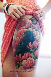 Raven on Flowers Thigh Tattoo