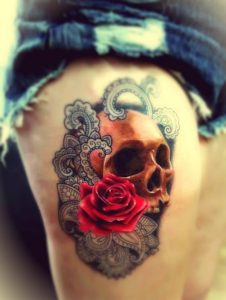 Realistic Skull and Rose Thigh Tattoo