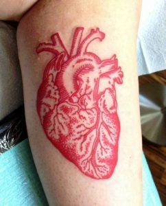 Red Anatomical Heart Arm Tattoo