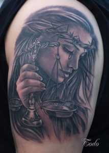 Shaded Lady with Scale Arm Tattoo