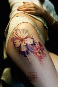Sketchy Watercolor Flower Thigh Tattoo