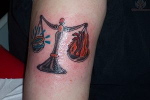 Small Heaven or Hell Scale Arm Tattoo