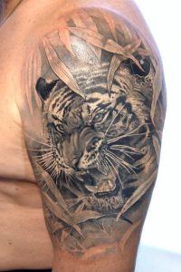 Sneaky Tiger Arm Tattoo