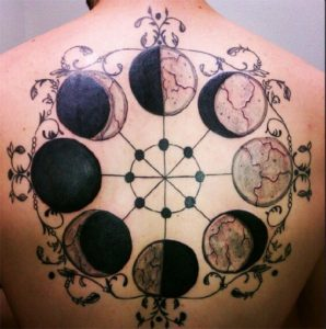 Solid Black Moon Phases with Artistic Encircling Border Full Back Tattoo