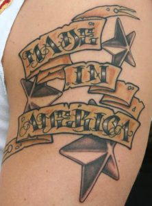 Stars and Words Arm Tattoo
