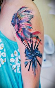 Swayed Lotus and Brushes Arm Tattoo