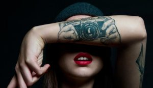 Taking a Picture Forearm Tattoo