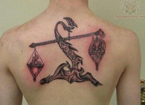 Traditional Good and Bad Scale Upper Back Tattoo
