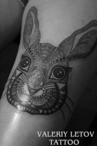 Tribal Inspired Bunny Thigh Tattoo