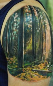 Watercolor Forest Arm Tattoo
