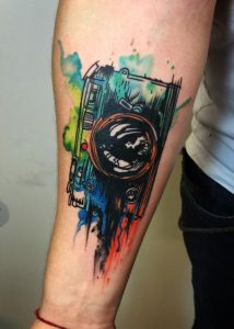 Watercolor Graphical Camera Forearm Tattoo