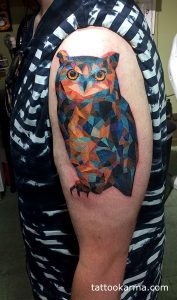Watercolor Owl Arm Tattoo
