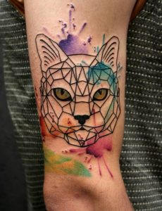 Watercolor Splashed Yellow-Eyed Arm Tattoo
